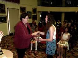 A student receives her award